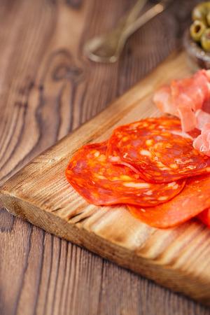 cured ham: Platter of serrano jamon Cured Meat, , chorizo and olives Stock Photo