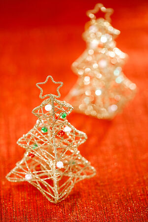 glitter christmas tree decoration on golden red background photo