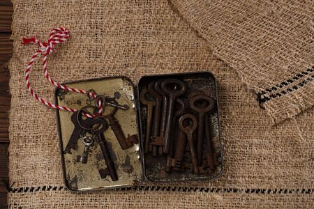 homespun: large rusty vintage metal keys in old tin in tin on old grain sacking linen Completely hand made  handwoven and homespun