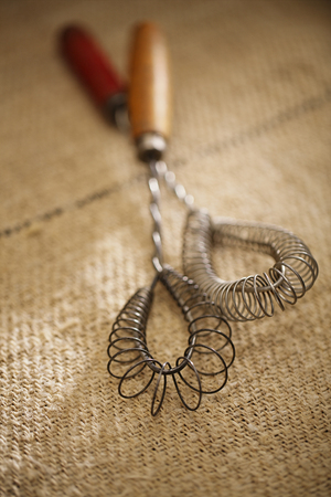 homespun: real vintage wooden wire whisk  on old grain sacking linen Completely hand made  handwoven and homespun