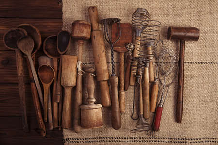 real vintage kitchen utensils on old grain sacking linen Completely hand made  handwoven and homespun photo