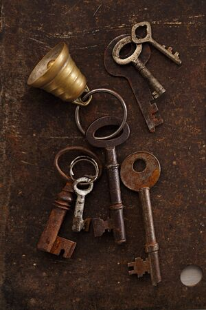 locksmith: iron keys with bell on metal backdrop, really vintage and old