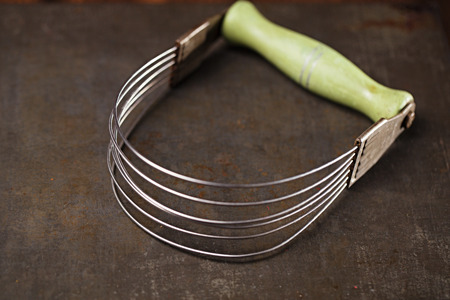 oncept: Vintage pastry blender with green handle