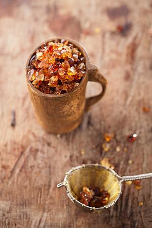 souk: Gum arabic, also known as acacia gum - in wooden mug