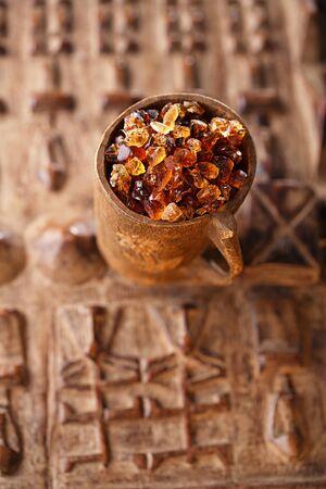 arabian food: Gum arabic, also known as acacia gum - in wooden mug