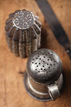 sifter: Vintage  Baking utensils - sifter, spatula, tins and moulds on wooden board