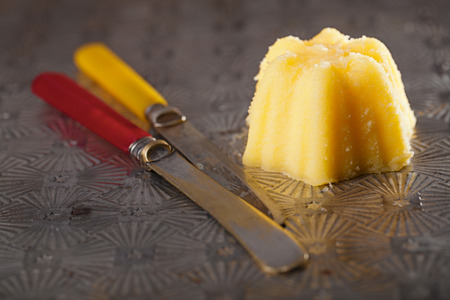 clarified: ghee or melted butter on metal background