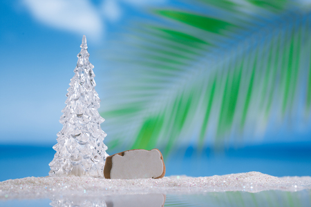 christmas tree ball: glass christmas tree  ball on  beach with seascape background