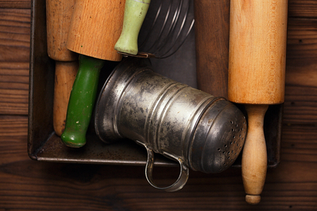 sifter: Vintage  Baking utensils collection - rolling pins and flour sifter Stock Photo