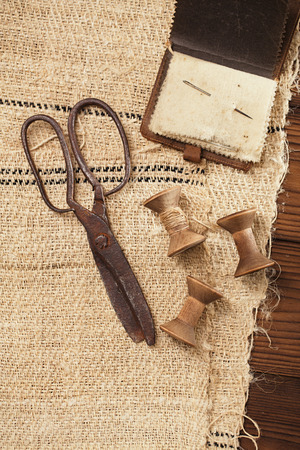 old spools: really antique iron scissors with spools on old grain sacking linen Completely hand made  handwoven and homespun