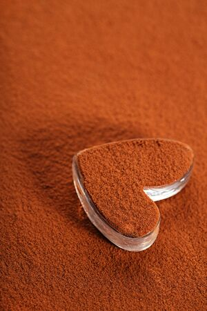 chocolate powder: cocoa chocolate powder with dusted heart shaped glass, perfect color and background