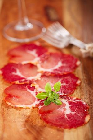antipasti: antipasti Platter of Cured Meat  jamon and wine, closeup Stock Photo