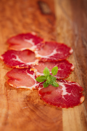 cured: antipasti Platter of Cured Meat  jamon and wooden background , closeup Stock Photo