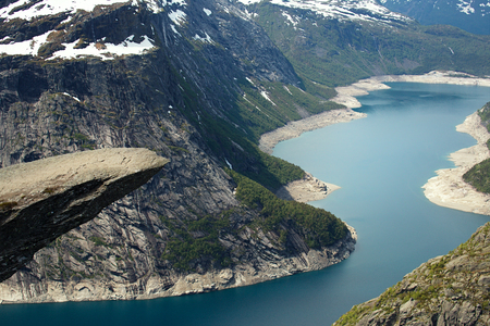 scandinavian landscape: Trolltunga  orTrolls tongue is a piece of rock jutting horizontally out of a mountain about 700 metres, Norway Stock Photo
