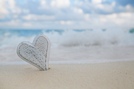 live action: wooden heart in sea waves, live action ... , shallow dof