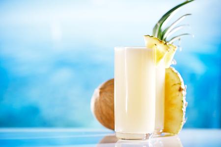 pina: pinacolada pina colada cocktail on beach with seascape background Stock Photo