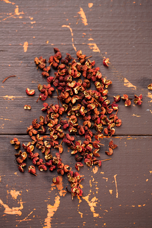 red pepper: Chinese Sichuan pepper on old wooden background Stock Photo