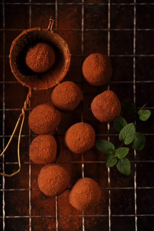 cocoa powder: chocolate truffles cocoa powder dusted and sieve, shallow dof