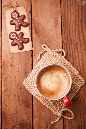 hot coffees: coffee in unusual vintage tin mug with red handle on old wood  with chocolate candy