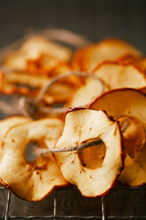 Dried apple slices and wooden backdrop Stock Photo