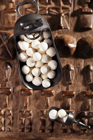 kurt kurut - asian dried yogurt balls on carved wooden background