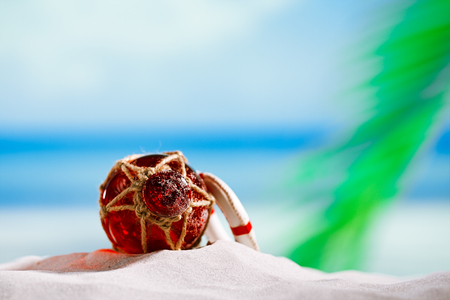 red Glass float on beach sand and sea blue background Stock Photo