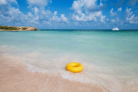 floating ring on blue clear sea and beach, shallow dof