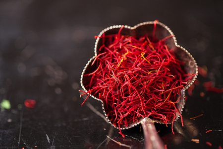 saffron space threads in vintage silver bowl on dark metal background Stock Photo - 87787552