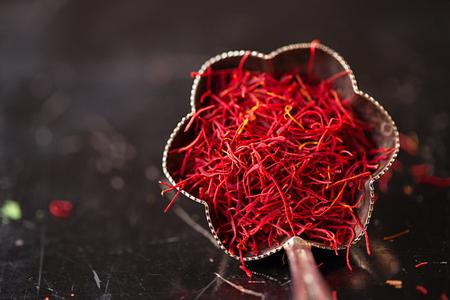 saffron space threads in vintage silver bowl on dark metal background