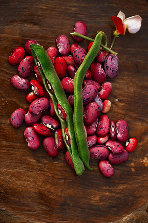 scarlet running beans - pod, flower and beans on wooden table Stock Photo