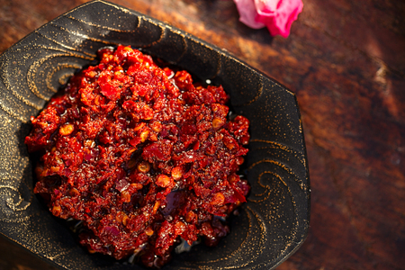 Traditional home-made  rose harissa - morrocan red hot chilles paste Standard-Bild