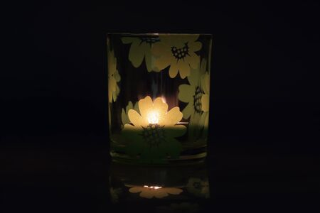 lit candle: A glass with a lit candle.
