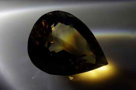 diffraction: Smoky quartz. Smoky topaz. Cut stone. Stock Photo