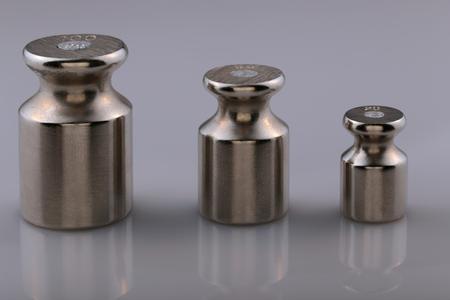 weigher: Metal weights to determine weight. Stock Photo