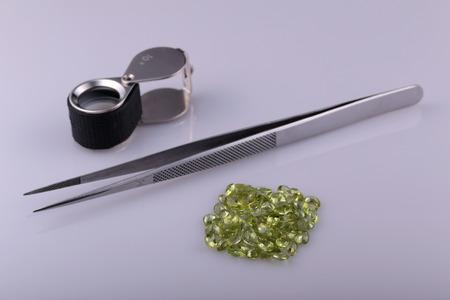 gemology: Natural Peridot and tools gemologist. Stock Photo