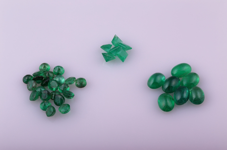 gemology: Natural emerald different shapes in the collection. Stock Photo