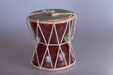 souvenir traditional: A small souvenir and traditional Indian drum.