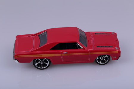 imitations: Small toy car model red.