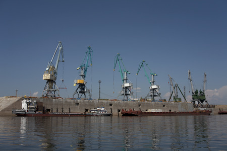fluvial: Port cranes on the bank of the Lena River. Yakutia. Russia.