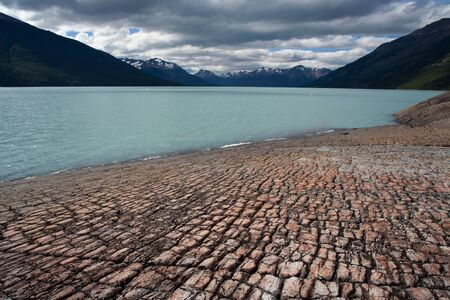 turbid: The rocky shore of Lake Argentino. Argentina. Patagonia. National Park Los Glacyares. Stock Photo