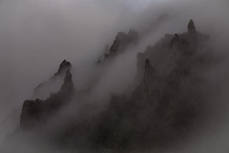 vague: Mystic rocks in the fog. Magadan Region. Koni peninsula. Russia.