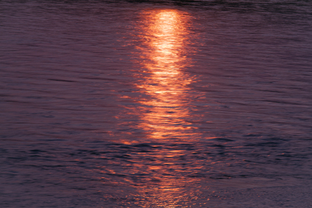 sun track: Red sun track on water. The surface of the river. Stock Photo