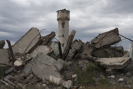 lovelorn: The ruins of the abandoned village Burkandya. Magadan Region. Russia. Stock Photo
