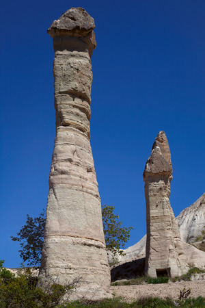 tall chimney: Unusual landscapes and buttes of Cappadocia. Turkey. Anatolian Plateau.