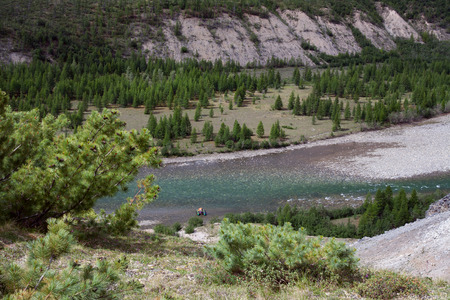 elfin: Top view of the mountain river and the catamaran from shore. Omulevka River. Magadan Region. Russia. Stock Photo