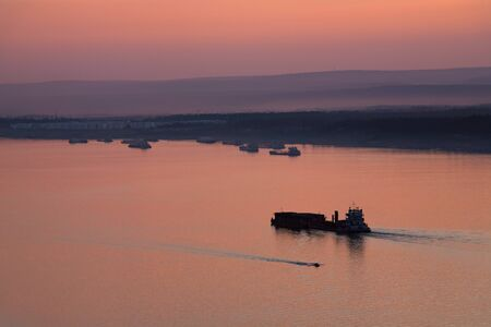 lena: Barge with cargo going up the river. Lena river. Yakutia. Russia.