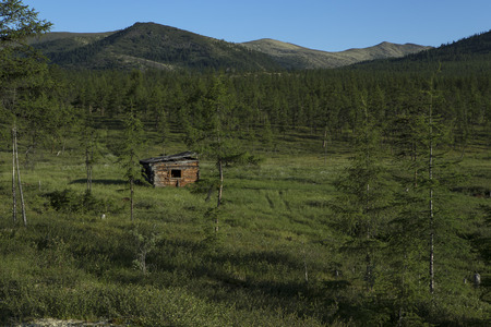 disrupted: Old abandoned cabin in the mountains. Moma Mountains. Yakutia. Russia.