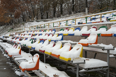 emptied: The seats of the arena under the snow. The city of Vladikavkaz. North Ossetia. Russia.
