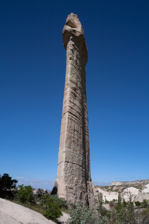 tall chimney: Unusual landscapes in the valley of love. Cappadocia. Turkey. Stock Photo