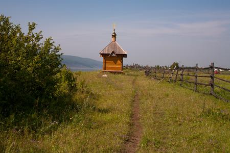 lena: Wooden Orthodox chapel on the outskirts of the village. Lena river. Yakutia. Stock Photo